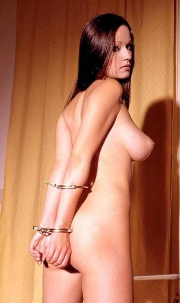 Handcuffed nude woman