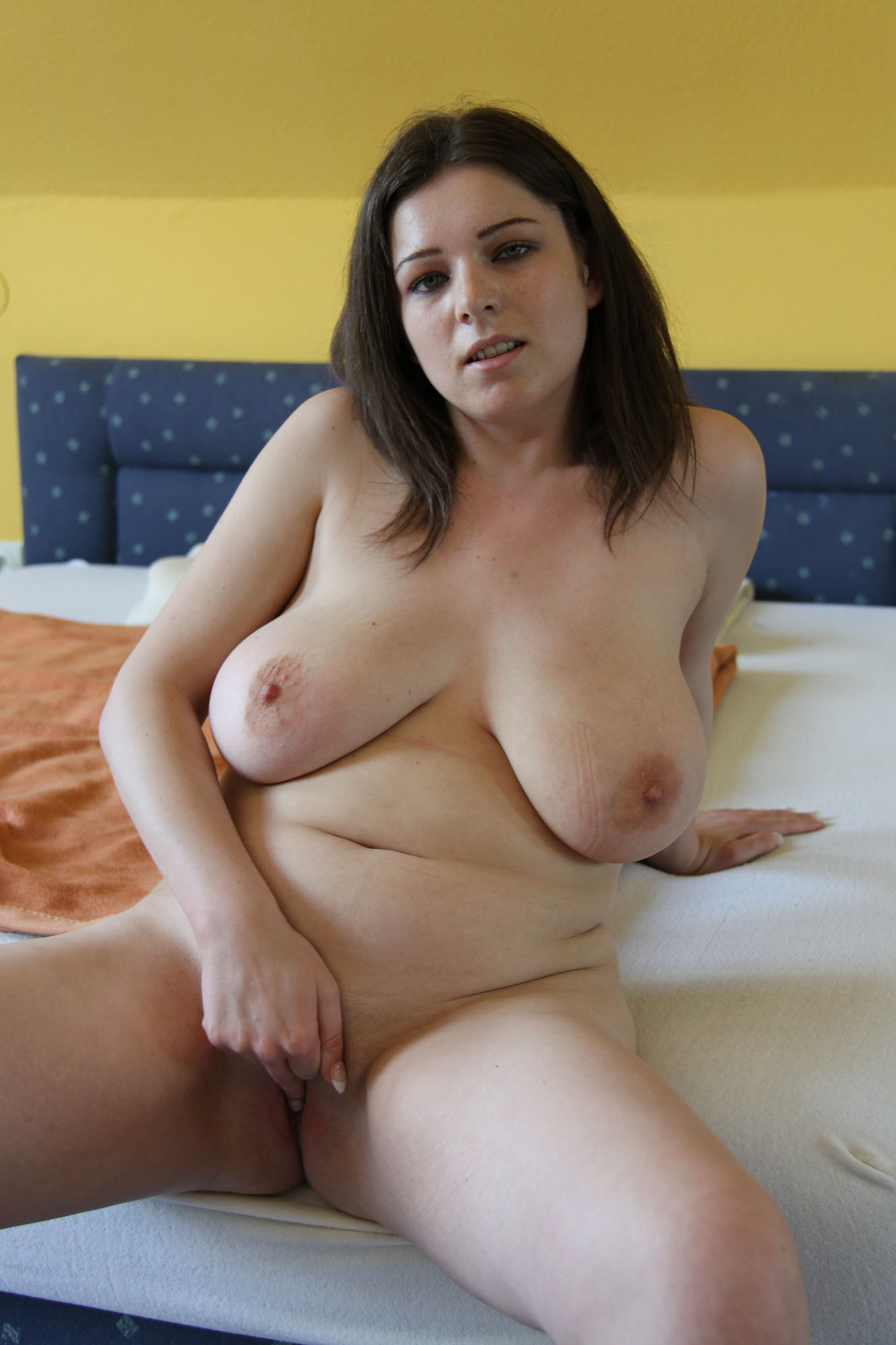 Bed nude tanning mom