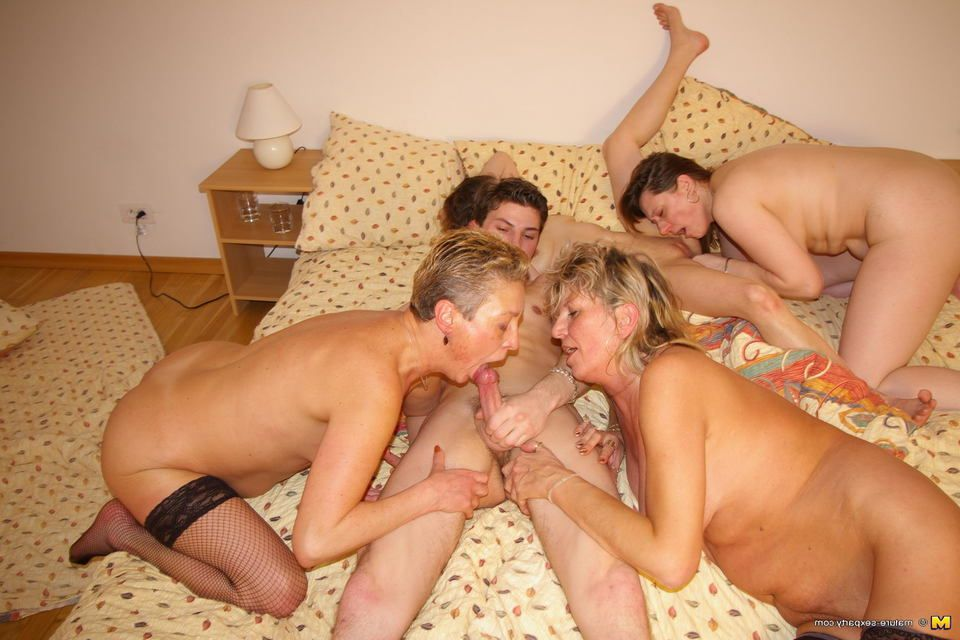Nude moms spreading in bed