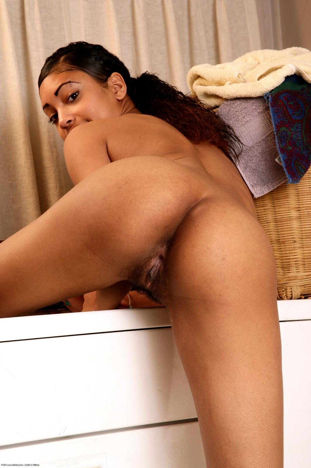 Young nude black girl spreading