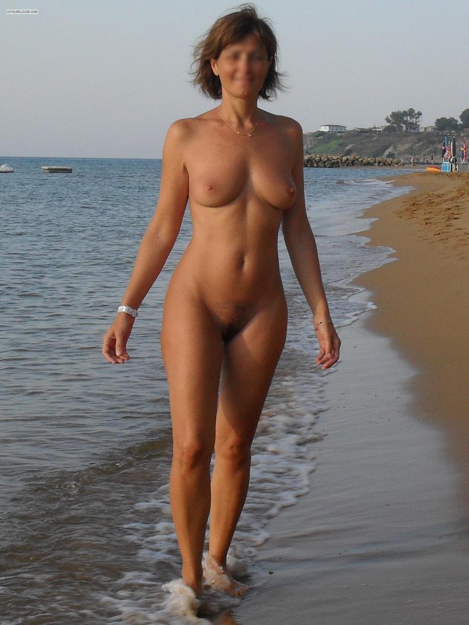 Nude wife on beach